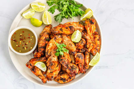 Photo pour Baked Cilantro Lime Chicken Wings with Fresh Lime and Cilantro Top Down Photo - image libre de droit