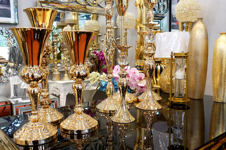Various golden vases and other decor items on the counter.