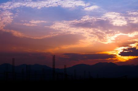 Photo pour Construction site view of scaffolding poles on building site sunset - image libre de droit