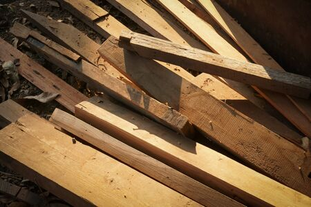 Photo pour Pile of wood logs for build Furniture production,sew natural wood scraps, ready to recycle and reuse process in improved waste management under efficient sustainable approach to save environment - image libre de droit