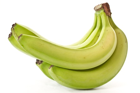 bunch of green bananas on immature white