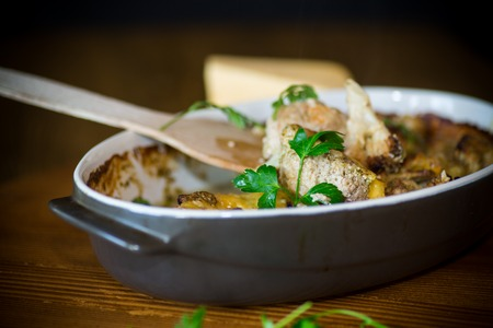 Photo pour Cauliflower baked with meatballs in cheese sauce, in ceramic form on a wooden table. - image libre de droit
