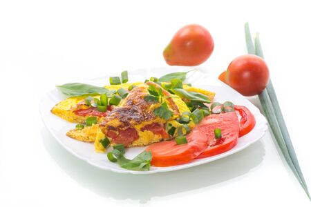 Photo pour fried omelet from homemade organic eggs with tomatoes and green onions - image libre de droit