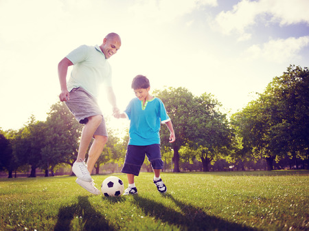 Family Father Son Playing Football Summer Concept