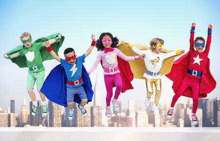 Photo pour Superheroes Kids Friends Playing Togetherness Fun Concept - image libre de droit