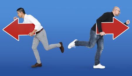 Photo pour Businessmen running in different directions - image libre de droit