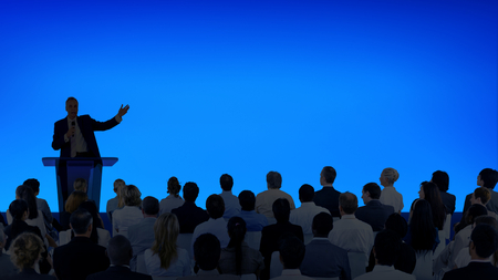 Photo for Corporate businessman giving a presentation to a large audience - Royalty Free Image