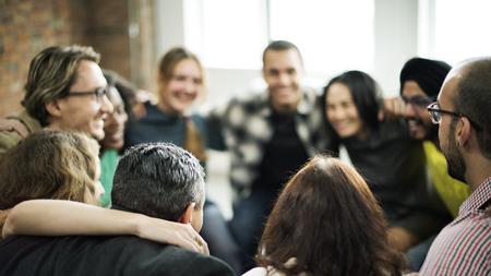 Photo pour Happy people huddling in a room - image libre de droit
