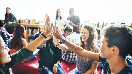 Photo pour Diverse students giving high five to team - image libre de droit