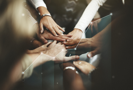 Photo for People joining hands in the middle - Royalty Free Image