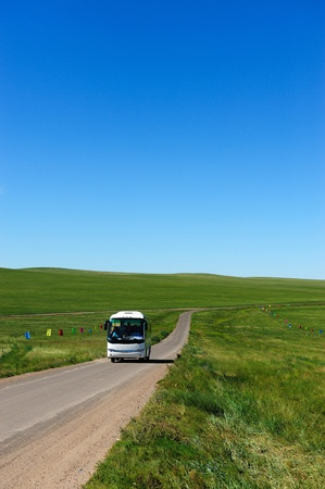 Bus in Hulun Buir grassland of Inner-Mongolia, China