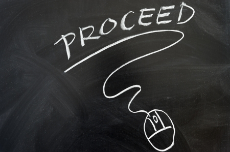 Proceed and mouse symbol drawn on the chalkboard