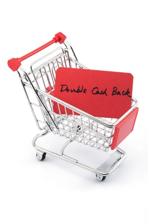 Double cash back words written on red paper card in shopping cart on white background
