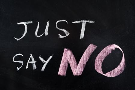 Photo pour Just say NO words written on blackboard - image libre de droit