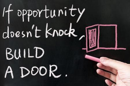 If opportunity doesn't knock, build a door words written on blackboard using chalk