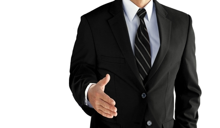 Photo pour Business man with an open hand ready to seal a deal over white - image libre de droit