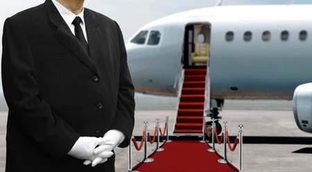 Photo pour Airplane pilot standing on red carpet before departure - image libre de droit