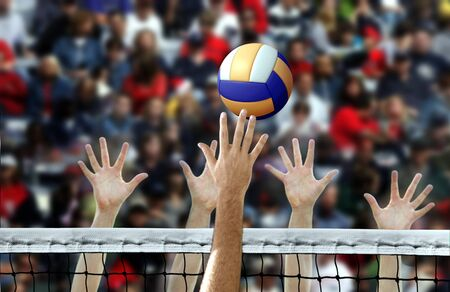 Photo pour Volleyball spike with hands blocking over the net - image libre de droit