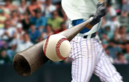Foto de Baseball player hitting ball with bat in close up - Imagen libre de derechos