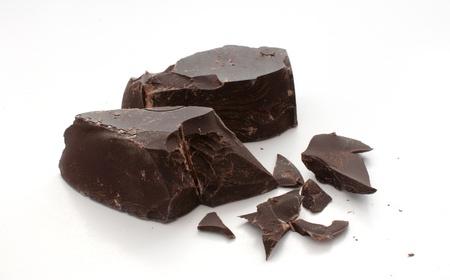 Cut and broken pieces of dark chocolate horizontal