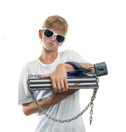 Lazy schoolboy in handcuffs with lock