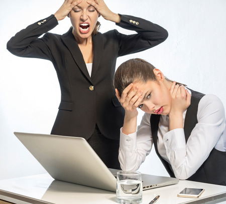 Angry teacher and resentful student at the computer
