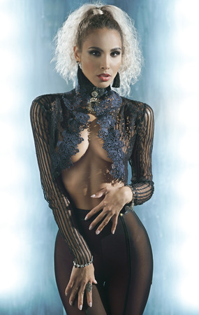 Sexy slim woman in a black transparent lingerie
