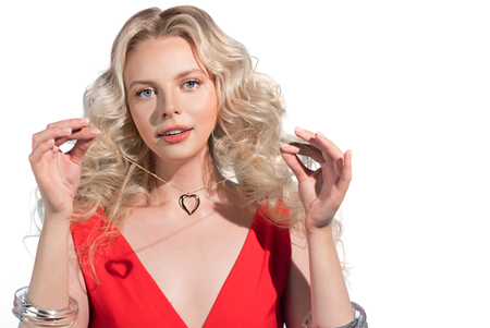 Photo pour Woman in red dress keeping heart shape jewelry. Concept of wealth and luxurious life - image libre de droit
