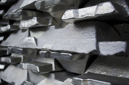 Stack of raw aluminium ingots in aluminium profiles factory