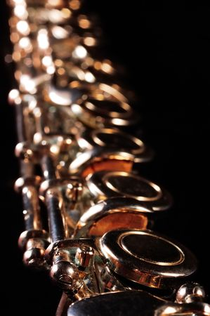 Detail of a Western concert flute, black background
