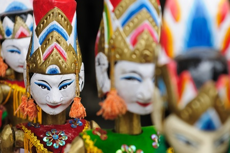 Souvenir from Bali island - traditional wood painting puppet. Indonesia.