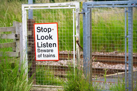 Photo for Stop look listen safety road sign at railway train station danger warning sign - Royalty Free Image