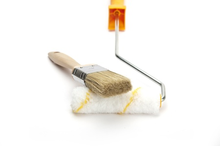 a paint brush with paint roller