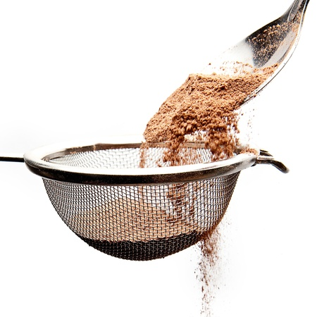 cocoa powder with a sieve and spoon