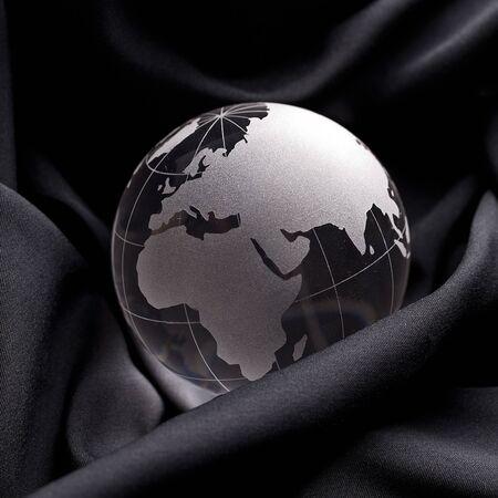 Glass globe on a silk cloth background