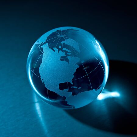 Glass globe on a metal background