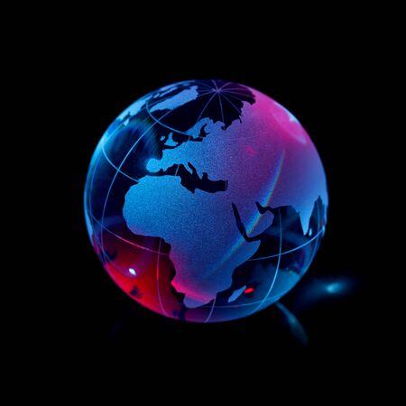 Glass globe on black background