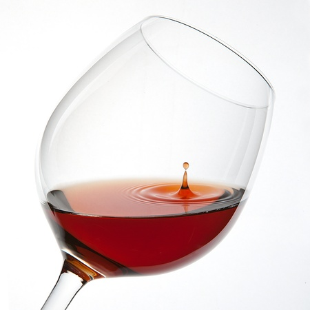 Red Wine Glas silhouette with a Drop on White Background