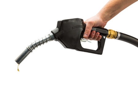 gas pump nozzle with hand and drop of golden gas isolated on white background