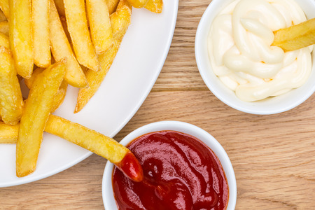 plate with fries with mayonnaise and ketchup