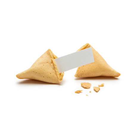 A single cracked fortune cookie with note and crumbs isolated on white background