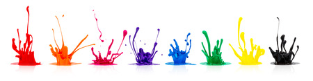 line of colorful paint splashes on white background