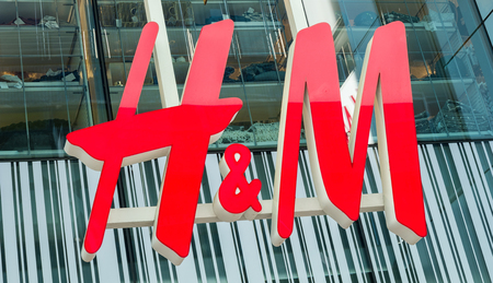 COLOGNE, GERMANY OCTOBER, 2017: H & M logo on a store. H & M Hennes & Mauritz AB is a Swedish multinational retail-clothing company, known for its fast-fashion clothing.