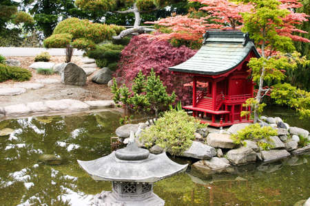 Japanese garden pond with pagoda, pruned maples and evergreens