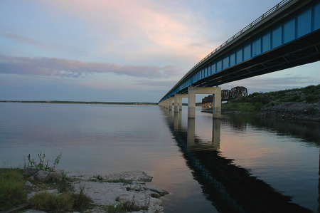 A bridge over the Amistad Dam in western Texas at dusk.