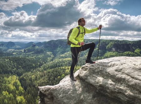 Photo for man backpacker running up on mountain top cliff edge. Travel and trail lifestyle concept adventure, outdoor summer vacations - Royalty Free Image