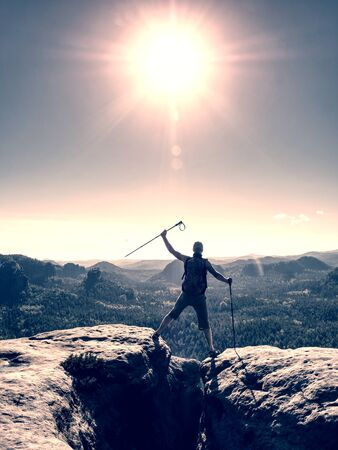 Photo for Successful man screaming with happiness on a mountain peak. Achieving of personal target - Royalty Free Image