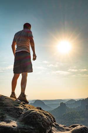 Photo pour Man on top of mountain. Conceptual design. Misty valley. Man hike.Person silhouette stand.Foggy mountains - image libre de droit