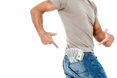 U S  dollars in the back jeans pocket isolated on white background