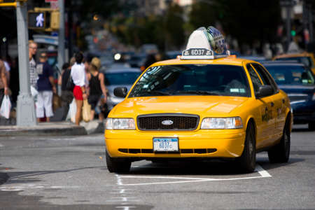 MANHATTAN, NY - November 7, 2011: Yellow cabs in the streets of Manhattan near the new york times building.